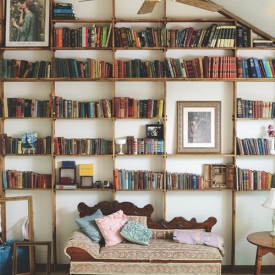 A Vaulted Floor To Ceiling Bookshelf